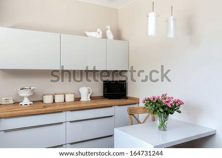 Bright space - a white and elegant kitchen corner - stock photo