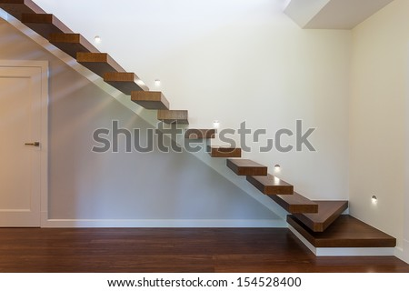 Bright space - modern geometric staircase with white walls - stock photo