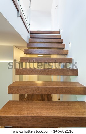Bright space - wooden stairs in a light and white apartment - stock photo