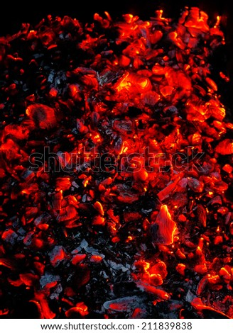 Bright sparkling embers as background                                - stock photo