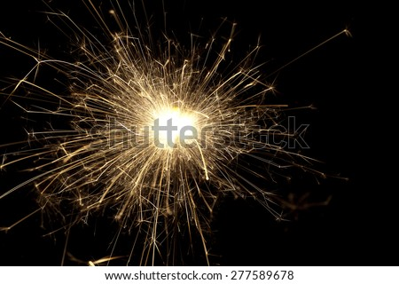 Bright sparks from a sparkler - stock photo