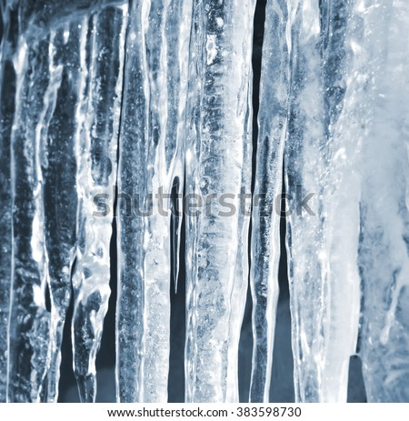 Bright spring background with icicles in the sunlight - stock photo