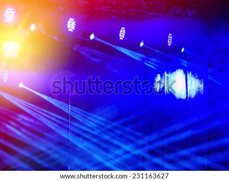bright stage lights on a dark background