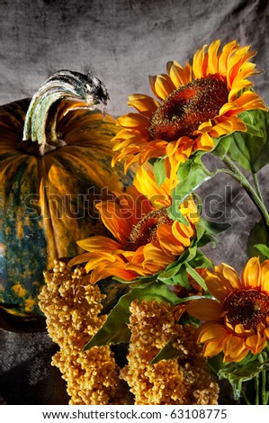 bright still life with pumpkin and sunflowers