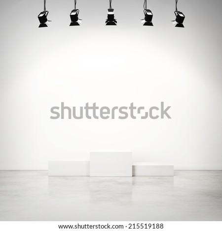 Bright studio interior with empty white podium - stock photo
