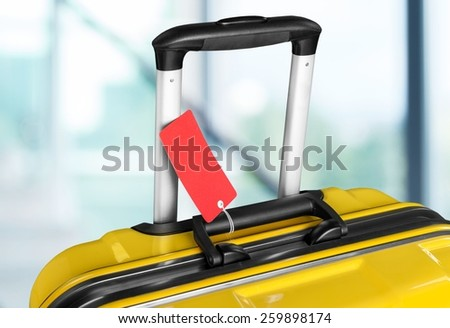 Bright suitcase with handle and label economy. Luggage at airport. Modern and elegant bag for travel. Object on white background. Tag with information on baggage. Bag for tourism and vacation. - stock photo