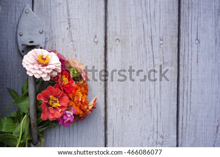 Bright summer flowers on an old wooden surface. Summer background with flowers. Soft focus