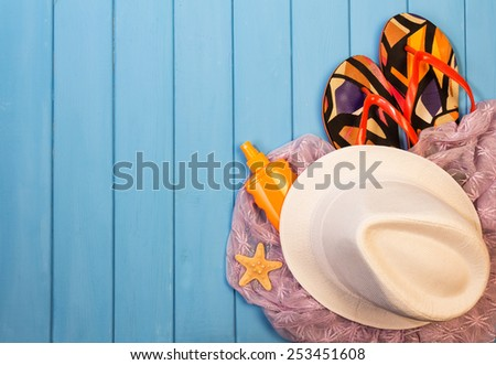 Bright summer hat and sandals on blue background - stock photo