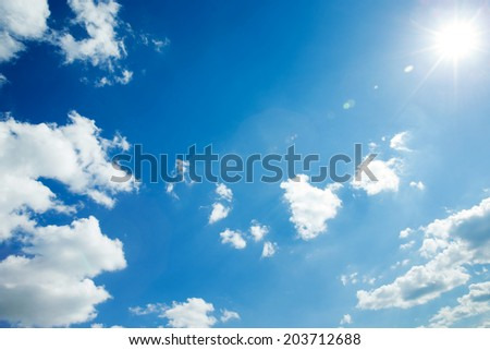 Bright sun and blue sky - stock photo
