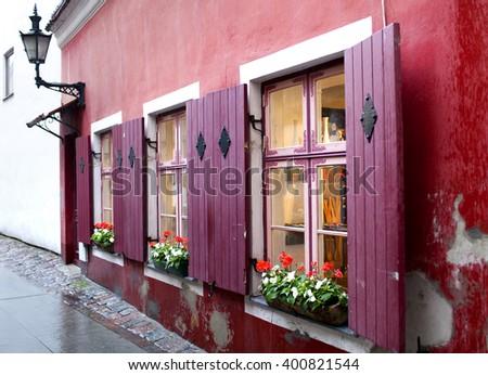 Bright sun blind of old houses during a rain. Tallinn. Estonia - stock photo
