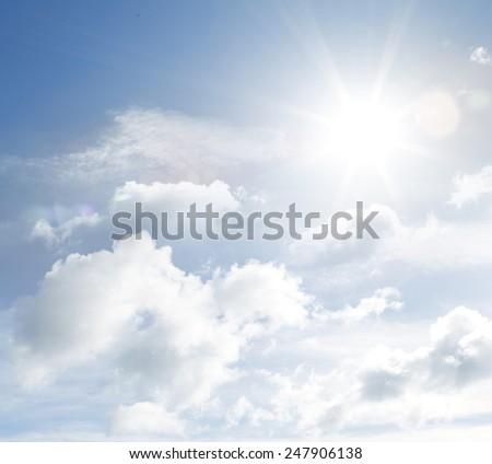 Bright sun in fluffy clouds  - stock photo