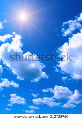 Bright sun in the blue sky - stock photo