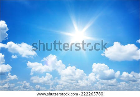 Bright sun in the blue sky  - stock photo