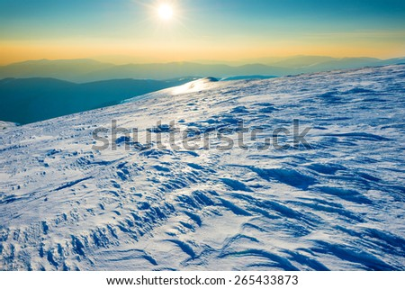 Bright sun in winter mountains covered with snow
