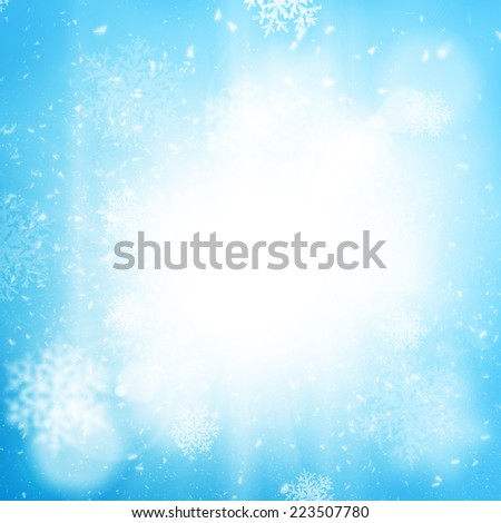 Bright sun light sky background with snow flakes - stock photo