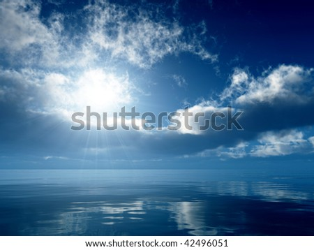 Bright sun over a gentle blue sea