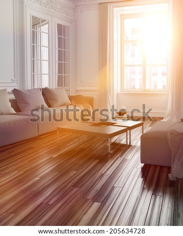 Bright sunlight streaming into a living room interior with a parquet floor and couch through a large window with lens flare effect - stock photo