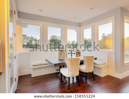 Bright Sunlit Dining Room and Nook in Luxury Home - stock photo