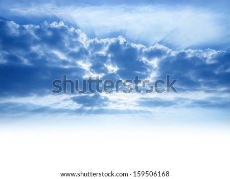 Bright sunrays make their way through cumulonimbus clouds, sky background with copy space, beautiful heaven, atmosphere concept - stock photo