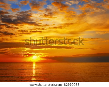 Bright sunset at the sea - stock photo