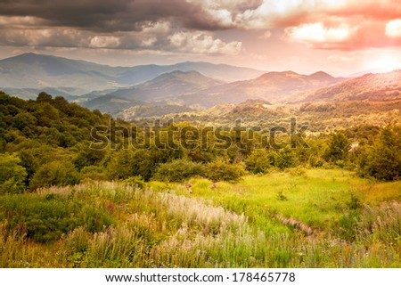 bright sunset in the mountains, sunset  landscape  - stock photo