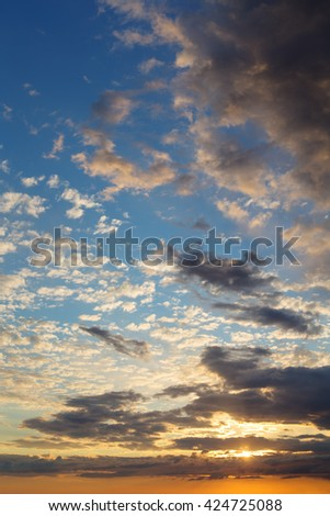 bright sunset sky with clouds, abstract background - stock photo