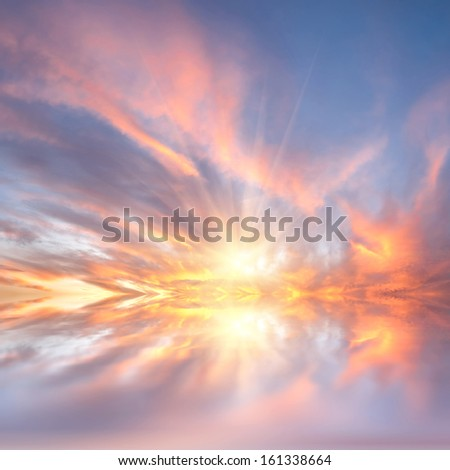 Bright sunset with beautiful clouds reflected in the calm water