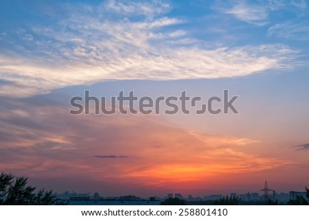Bright sunset with dramatic cloudscape over skyline  - stock photo