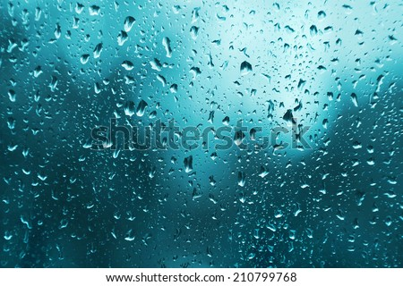 Bright texture of water drops on glass - stock photo