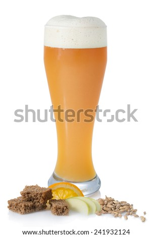 Bright unfiltered beer with foam in the glass on a white background with malt, bread and fruit - stock photo