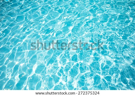 Bright water surface in swimming pool