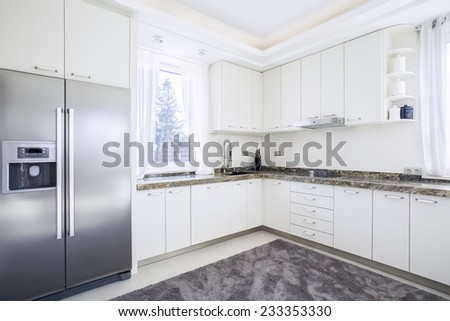 Bright, white and contemporary kitchen - stock photo