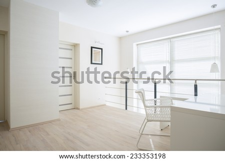 Bright, white corridor on mezzanine floor - stock photo