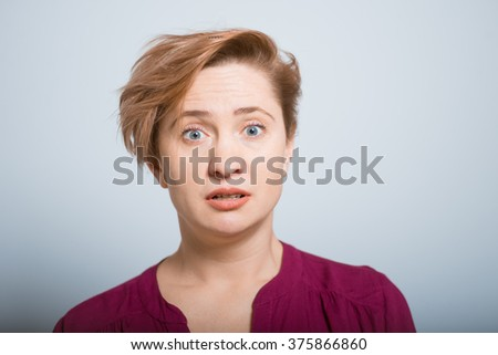 bright woman, shoked face isolated studio - stock photo