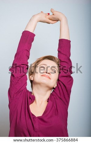 bright woman stretching  after waking up, isolated studio - stock photo