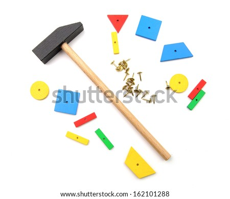 Bright wooden pieces and a hammer for the hammer game - stock photo