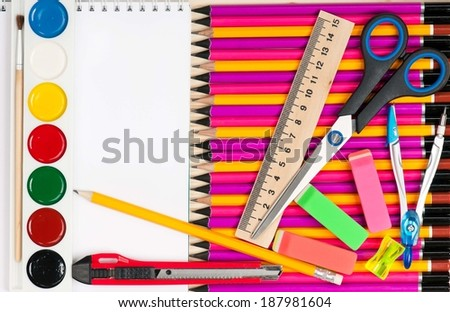 Bright writing-materials for learning on a table close-up - stock photo