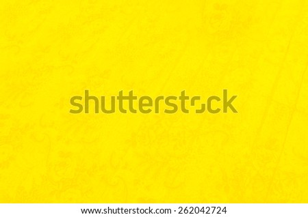 Bright, yellow background with a subtle flower pattern - stock photo