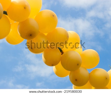 Bright yellow balloons, in a row, decorations at a fair, festival or party - stock photo