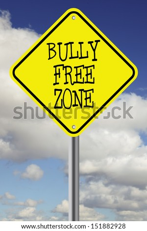 Bright yellow bully free zone road sign against a beautiful cloudscape - stock photo