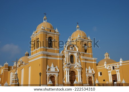 Bright yellow colonial style Cathedral in the Plaza de Armas of Trujillo, Peru - stock photo