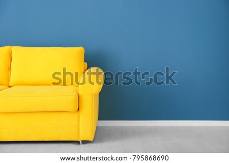 Bright Yellow Couch Near Color Wall Stock Photo 795868690 - Shutterstock