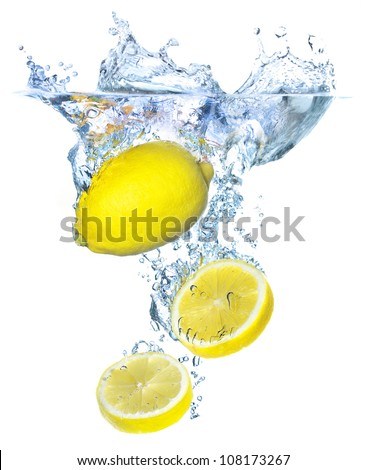 Bright yellow lemons and water splash. Tasty and healthy food