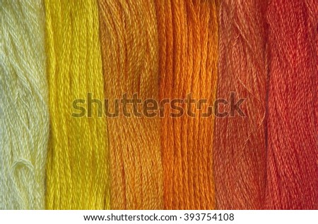 Bright yellow range of colors thread floss for embroidery and needlework. Sewing threads for embroidery close-up. Multicolor sewing threads texture. Mouline.  - stock photo