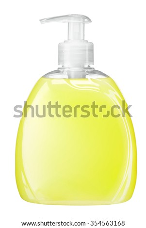 Bright yellow soft soap / Liquid soap bottle with pump / studio photography of transparent bottle with yellow liquid - isolated on white background - stock photo