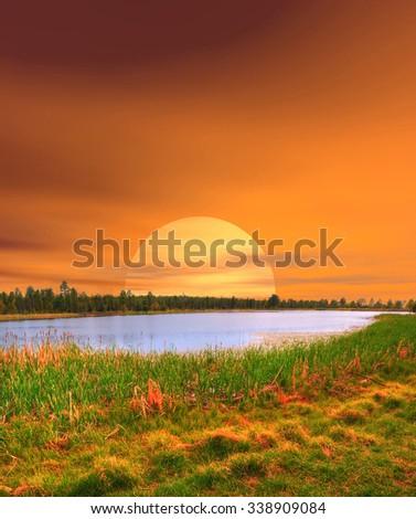 Bright yellow Sunrise Lake of the Woods Arizona - stock photo