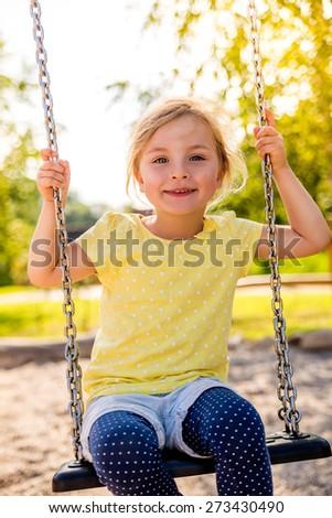 brighter day child swinging high - stock photo