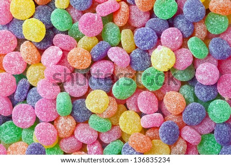 Brightly colored and sugar coated candy as a background. - stock photo