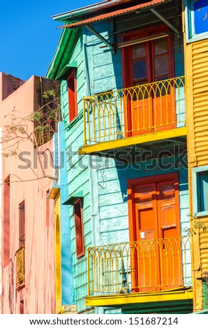 Brightly colored balconies on a dilapidated building in La Boca neighborhood of Buenos Aires - stock photo