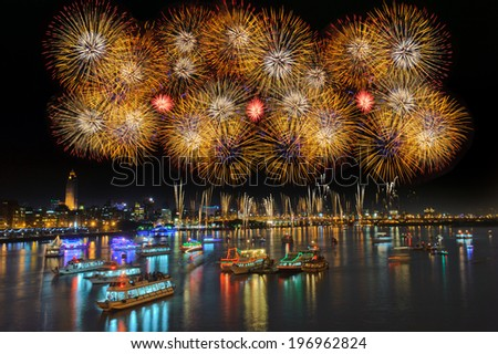 Brightly colored boats in the water during a celebration. - stock photo